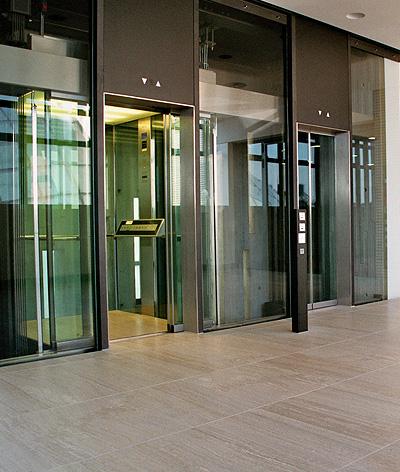 public glass lift
